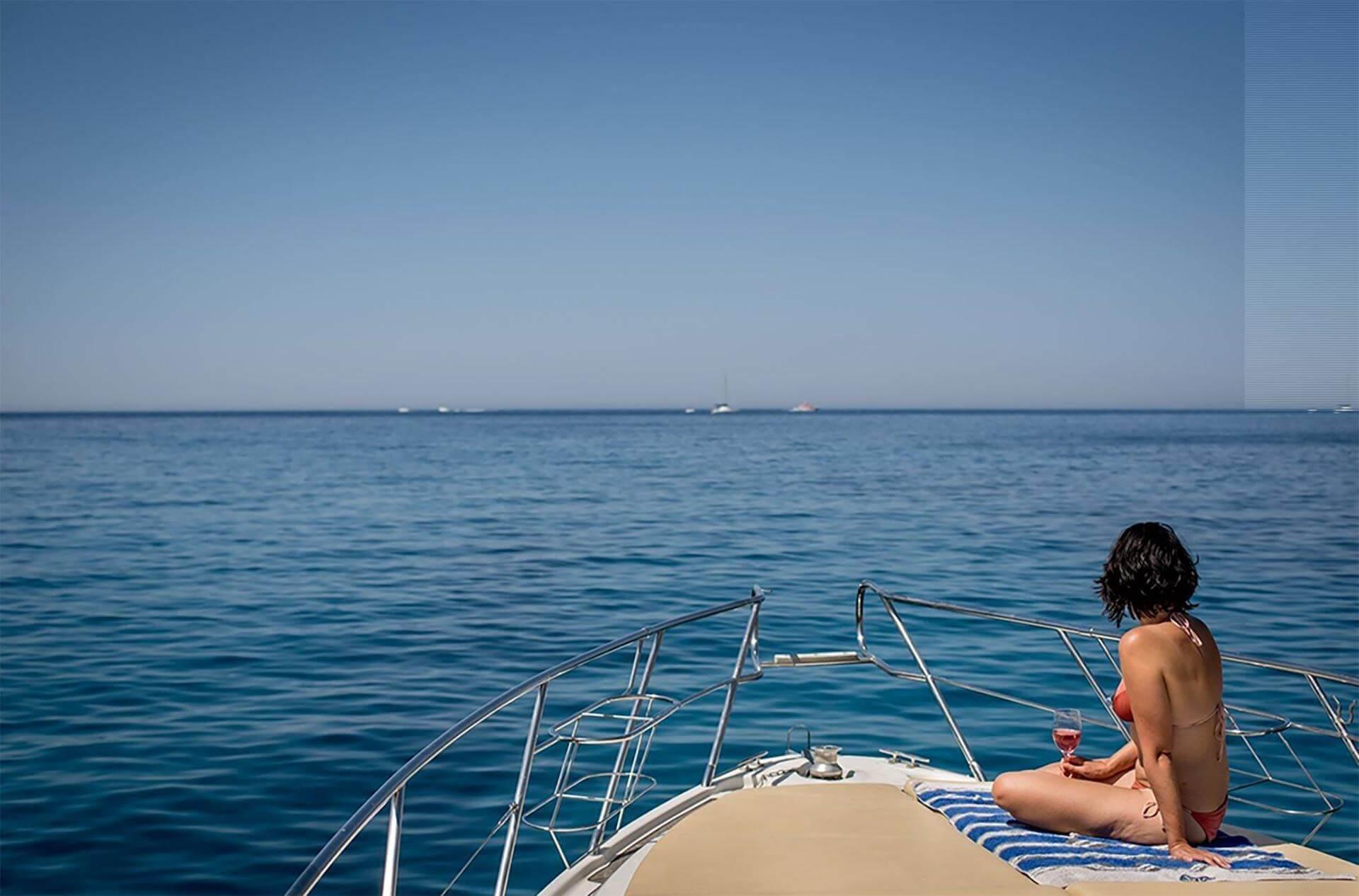 Girl Sunbathing On Yacht