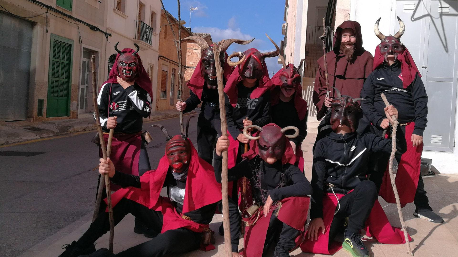 San Antoni Campos kids dressed as demons on their way to school mallorca min