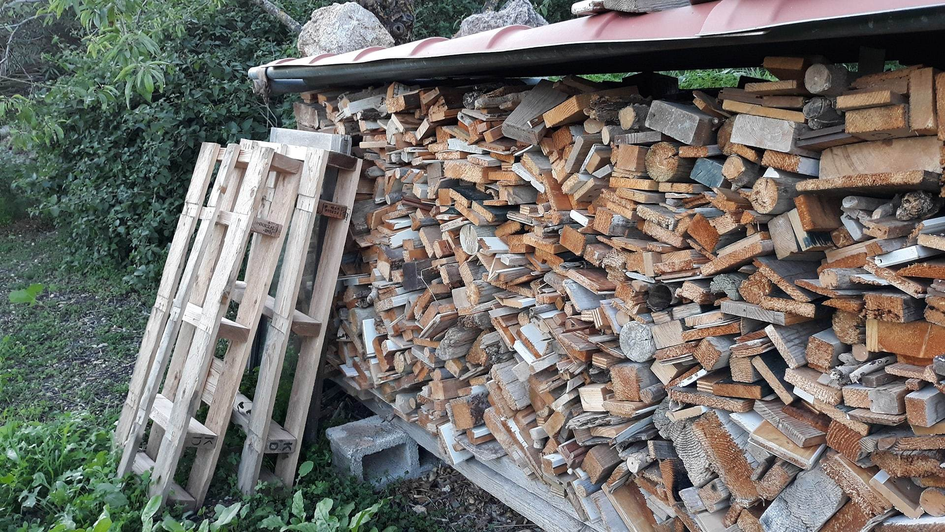 Stock of wood fire Mallorca Winter min