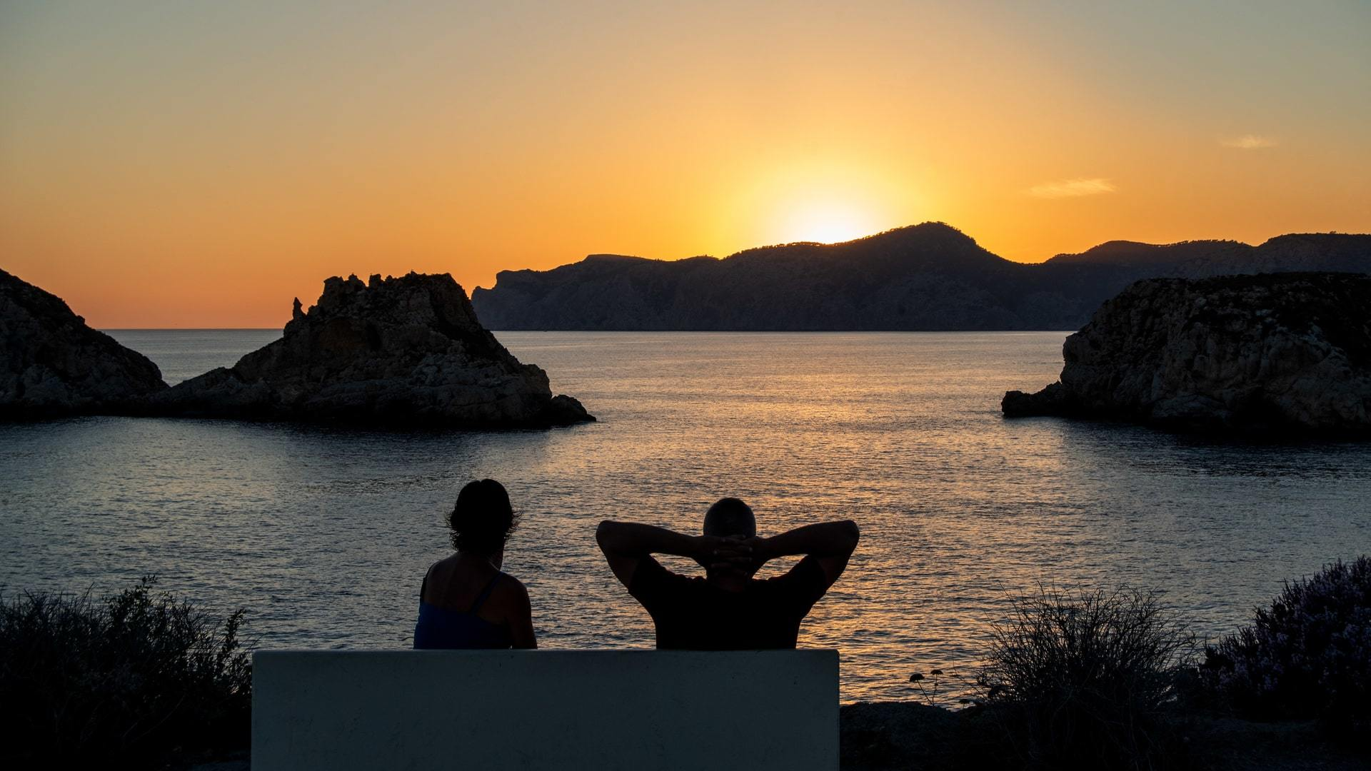 Valentines Day on the Island of Love couple watching sunset together Sa Dragonera Mallorca min