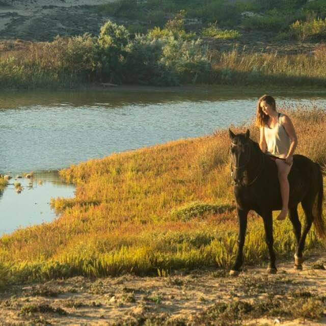 Girl on bareback horse