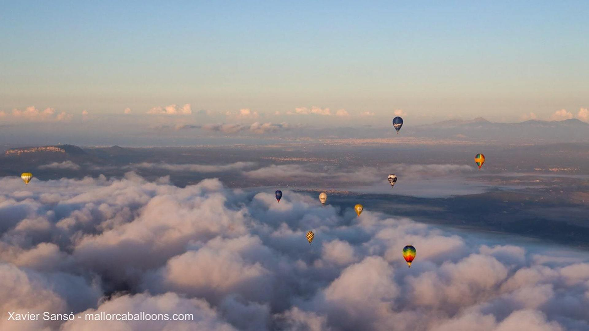 Hot air balllons flying over cloud mallorca island min