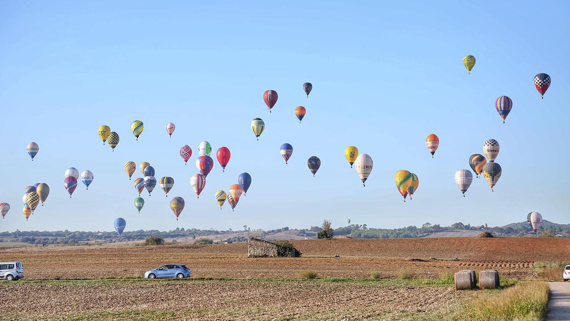 Hot air balloons over Mallorca road min