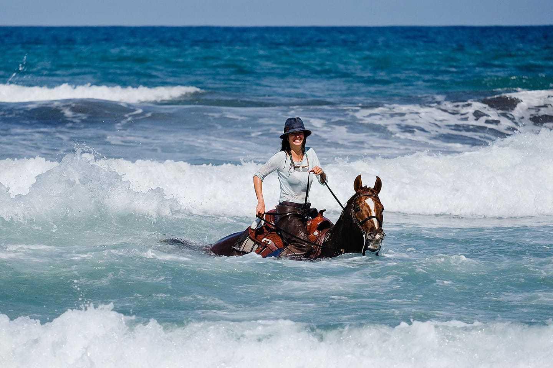 Lady on horseback in sea
