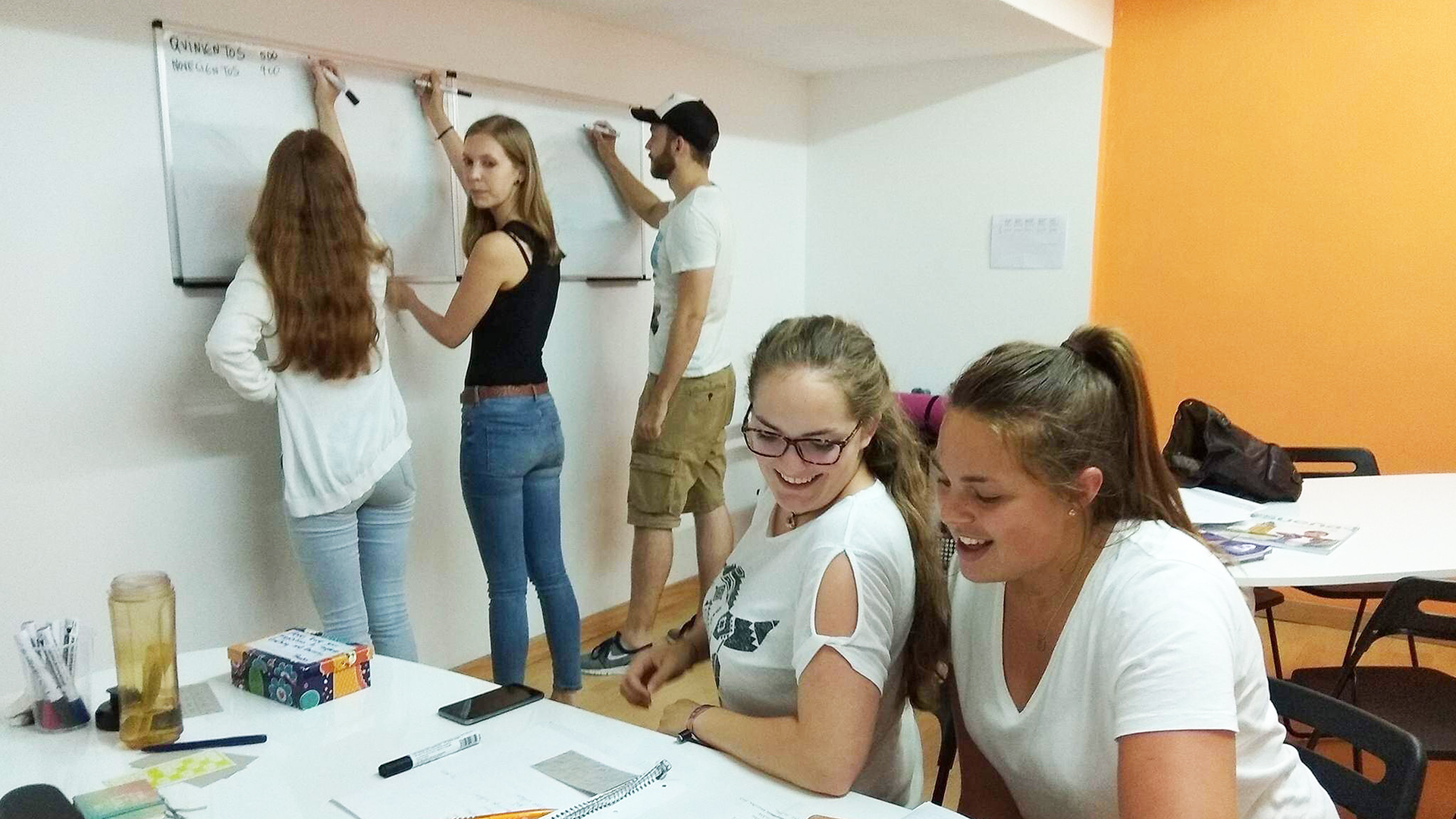 Students learning spanish group class